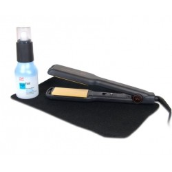 GHD wide hair straightener and Wella iron spray